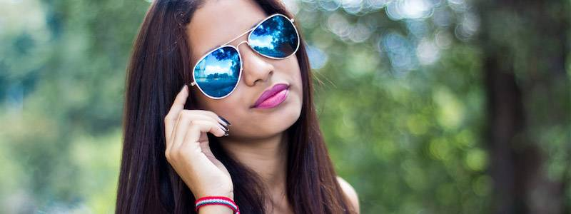 b456984041 Brunette wearing Blue Tinted Sunglasses 800×300